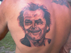 Tattoo of Jack Nicholson on persons back